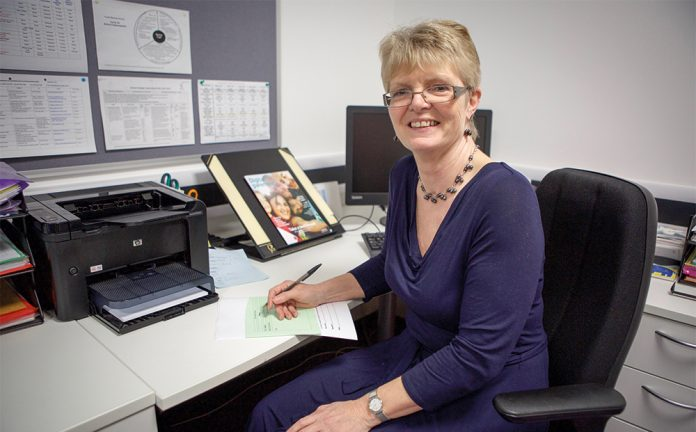 karen simpson at desk