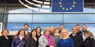 Justisigns team outside EU building