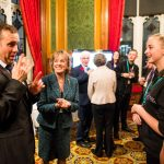 Exeter Deaf Academy student Molly speaking with Dame Esther-Rantzen through BSL Interpreter Tim Griffin at the House of Lords.
