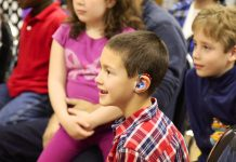 Child with hearing aid in school